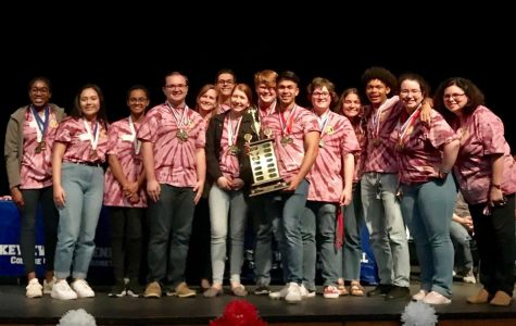 The decathlon team that is comprised of juniors and seniors are presented with the district first place trophy and medals. The team competed in ten categories against all GISD high schools.